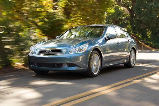 AUT 29 JF0001 01 © Kimball Stock 2007 Infiniti G35 Blue 3/4 Front View On Road In Motion