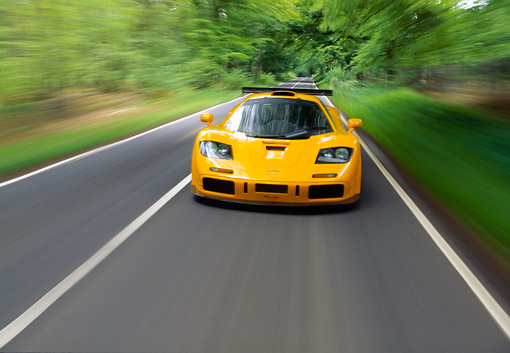 AUT 29 RK0001 03 © Kimball Stock 1996 McLaren F1 LM Orange Head On On Road In Motion