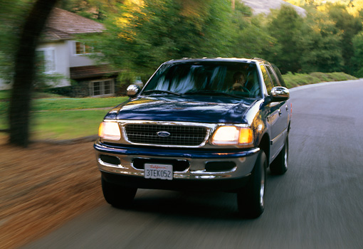 AUT 29 RK0005 06 © Kimball Stock 1997 Ford Expedition Blue Front 3/4 View On Road In Motion
