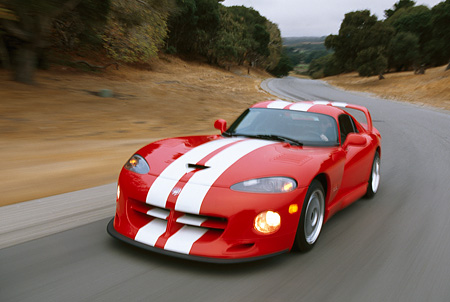 AUT 29 RK0007 36 © Kimball Stock 1997 Dodge Hennessey Viper Venom 600 GTS Red White Stripe 3/4 Front View On Road In Motion By Trees