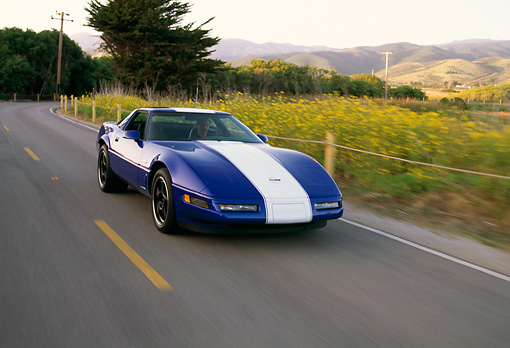 AUT 29 RK0012 01 © Kimball Stock 1996 Chevrolet Corvette Grand Sport Blue And White Front 3/4 On Road In Motion