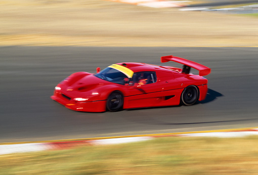 AUT 29 RK0028 02 © Kimball Stock Ferrari F-50 GTR1 Red 3/4 Front View On Race Track In Motion