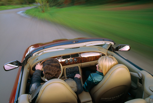 AUT 29 RK0044 07 © Kimball Stock 1997 Jaguar XK8 Convertible Red Overhead On Road In Motion