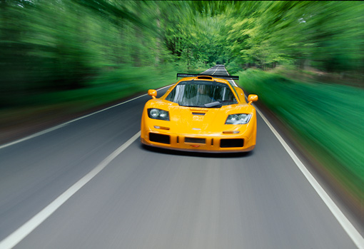 AUT 29 RK0125 14 © Kimball Stock 1996 McLaren F1 LM Orange Head On View On Road In Motion