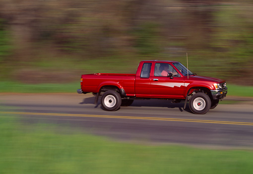 AUT 29 RK0136 18 © Kimball Stock 1992 Toyota Pickup Truck Red Profile View On Road In Motion