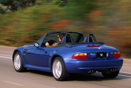 AUT 29 RK0163 12 © Kimball Stock 1999 BMW M Roadster Z3 Convertible Blue 3/4 Rear View On Road In Motion