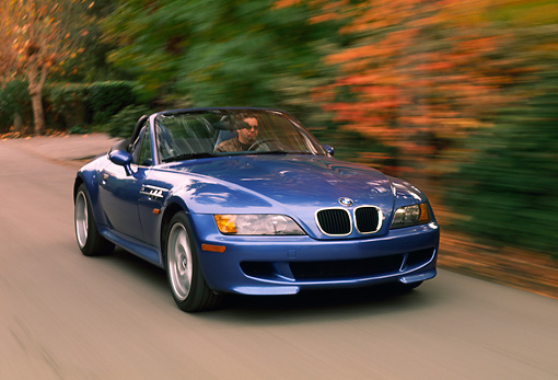 AUT 29 RK0177 01 © Kimball Stock 1999 BMW M Roadster Z3 Convertible 3/4 Front View On Road By Trees
