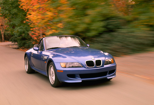 AUT 29 RK0177 02 © Kimball Stock 1999 BMW M Roadster Z3 Convertible 3/4 Front View On Road By Trees