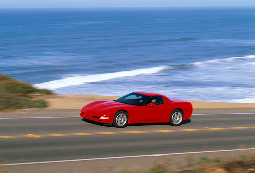 AUT 29 RK0272 03 © Kimball Stock 1999 Chevrolet Corvette Red 3/4 Front View On Road In Motion