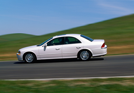 AUT 29 RK0325 04 © Kimball Stock 2000 Lincoln LS Sport Sedan White Profile View On Road In Motion