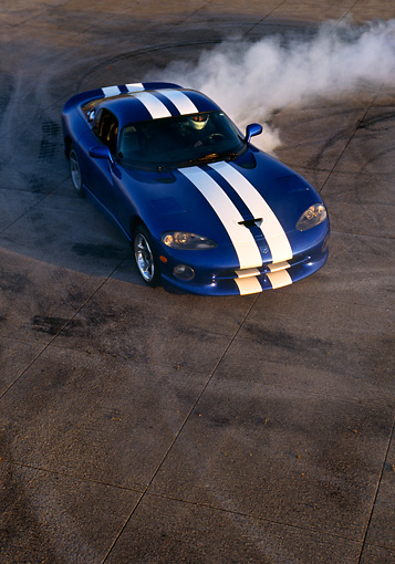 AUT 29 RK0330 18 © Kimball Stock 1997 Dodge Viper Blue White Stripe Overhead Burning Tires On Pavement