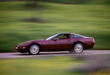 AUT 29 RK0396 05 © Kimball Stock 1993 Chevrolet Corvette Burgundy Profile Shot On Road In Motion