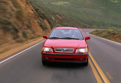 AUT 29 RK0412 02 © Kimball Stock 2001 Volvo V40 Red Head On Shot On Road In Motion