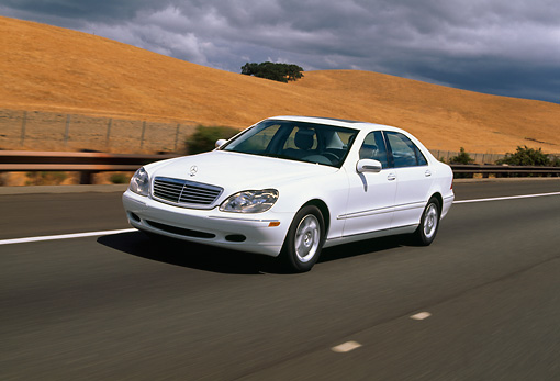 AUT 29 RK0429 01 © Kimball Stock 2000 Mercedes-Benz 500S White 3/4 Side View On Road In Motion