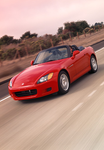 AUT 29 RK0450 01 © Kimball Stock 2000 Honda S2000 Convertible Red Slanted 3/4 Front View On Road In Motion