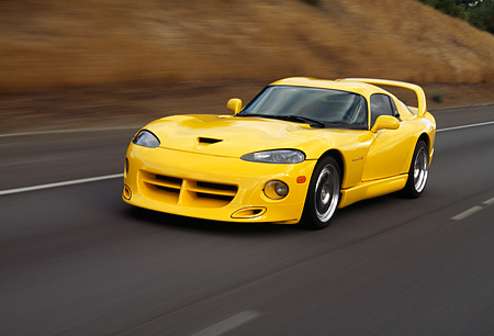AUT 29 RK0477 23 © Kimball Stock 1996 Dodge Hennessey Viper Venom 650R Yellow 3/4 Front View On Road In Motin