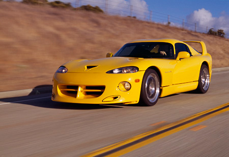 AUT 29 RK0478 03 © Kimball Stock 1996 Dodge Hennessey Viper Venom 650R Yellow 3/4 Front In Motion On Road