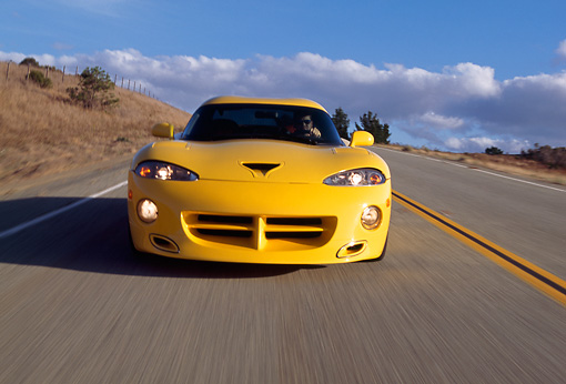 AUT 29 RK0480 12 © Kimball Stock 1996 Dodge Hennessey Viper Venom 650R Yellow Head On On Road In Motion