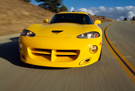 AUT 29 RK0481 02 © Kimball Stock 1996 Dodge Hennessey Viper Venom 650R Yellow Head On Shot On Road In Motion