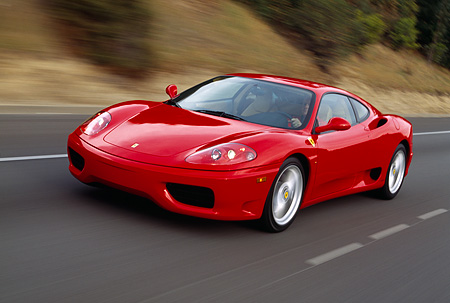 AUT 29 RK0494 15 © Kimball Stock 1999 Ferrari 360 Modena Red Front 3/4 View On Road In Motion