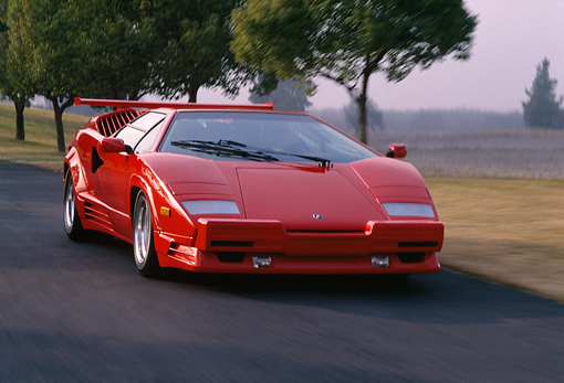 AUT 29 RK0524 15 © Kimball Stock 1989 Lamborghini 25th Anniversary Edition Red 3/4 Front View On Road In Motion