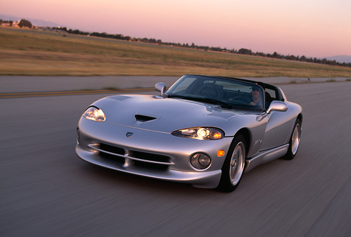 AUT 29 RK0543 25 © Kimball Stock 1998 Dodge Viper RT-10 Silver 3/4 Front View On Road In Motion