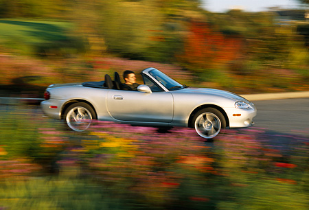 AUT 29 RK0571 02 © Kimball Stock 2001 Mazda Miata Convertible Silver 3/4 Rear View On Road In Motion