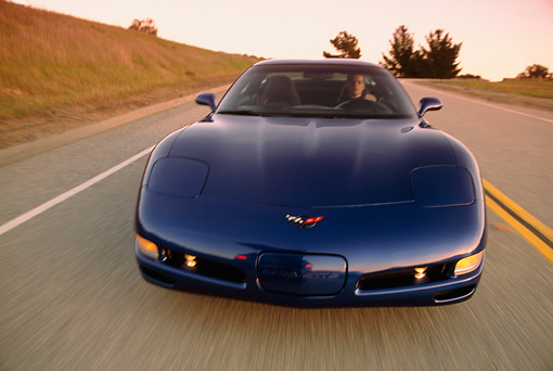 AUT 29 RK0588 02 © Kimball Stock 2002 Chevrolet Corvette Z06 Coupe Blue Head On View On Road In Motion