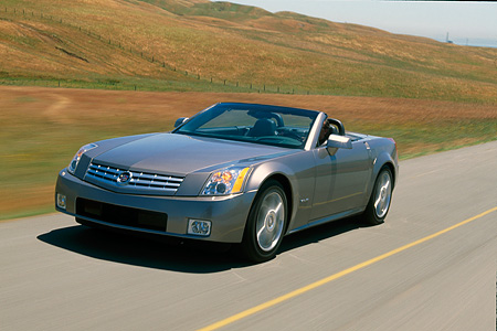 AUT 29 RK0597 22 © Kimball Stock 2004 Cadillac XLR Convertible Shale Metallic Front 3/4 View In Motion Grass Hills