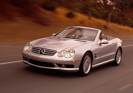AUT 29 RK0628 01 © Kimball Stock 2003 Mercedes-Benz SL55 AMG Roadster Silver 3/4 Front View On Road In Motion