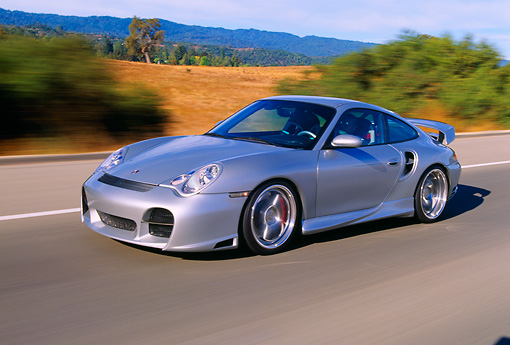 AUT 29 RK0656 08 © Kimball Stock 2004 Porsche X50 Turbo Silver 3/4 Front View On Road In Motion