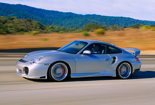 AUT 29 RK0657 05 © Kimball Stock 2004 Porsche X50 Turbo Silver 3/4 Front View On Road In Motion