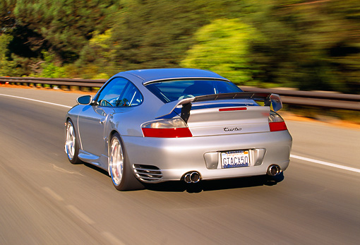 AUT 29 RK0658 11 © Kimball Stock 2004 Porsche X50 Turbo Silver 3/4 Rear View On Road In Motion
