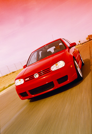 AUT 29 RK0675 05 © Kimball Stock 2005 Volkswagen R32 Golf Red Slanted 3/4 Front View On Road In Motion Filtered