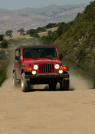 AUT 29 RK0803 01 © Kimball Stock 2004 Jeep Wrangler Red