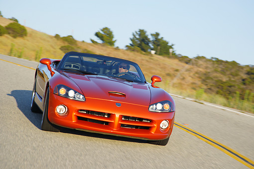 AUT 29 RK0856 01 © Kimball Stock 2005 Dodge Viper SRT10 Convertible Copper Head Orange 3/4 Front View On Road In Motion