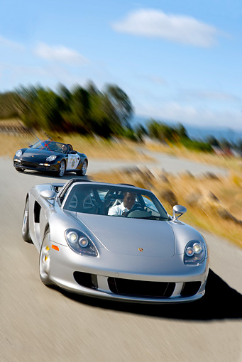 AUT 29 RK0877 01 © Kimball Stock 2005 Porsche Boxster S Police Car Chasing 2005 Porsche Carerra GT Silver  On Road