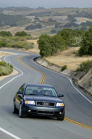 AUT 29 RK0956 01 © Kimball Stock 2004 Audi A6 Blue 3/4 Front View On Road In Motion On Hill