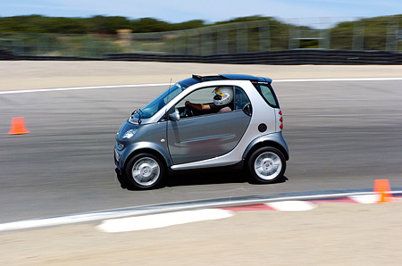 AUT 29 RK0980 01 © Kimball Stock Smart Fortwo Silver 3/4 Front View On Track In Motion