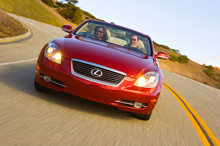 AUT 29 RK1011 01 © Kimball Stock 2006 Lexus SC430 Convertible Red Slanted Head On Shot On Road In Motion