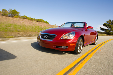 AUT 29 RK1012 01 © Kimball Stock 2006 Lexus SC430 Convertible Red 3/4 Front View On Road In Motion