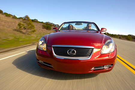 AUT 29 RK1014 01 © Kimball Stock 2006 Lexus SC430 Convertible Red Head On View On Road In Motion
