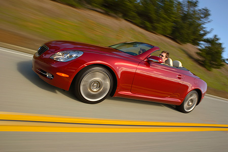 AUT 29 RK1015 01 © Kimball Stock 2006 Lexus SC430 Convertible Red 3/4 Side View On Road In Motion