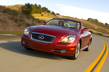 AUT 29 RK1016 01 © Kimball Stock 2006 Lexus SC430 Convertible Red 3/4 Front View On Road In Motion