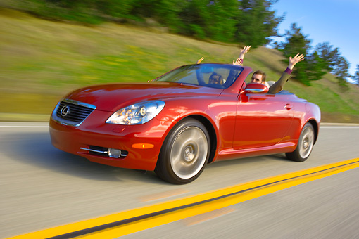 AUT 29 RK1152 01 © Kimball Stock 2006 Lexus SC430 Convertible Burgundy 3/4 Side On Road
