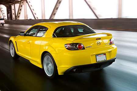 AUT 29 RK1159 01 © Kimball Stock 2005 Mazda RX8 Yellow 3/4 Rear View On Road In Motion