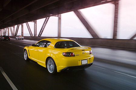 AUT 29 RK1160 01 © Kimball Stock 2005 Mazda RX8 Yellow 3/4 Rear View On Road In Motion