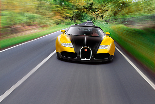 AUT 29 RK1186 01 © Kimball Stock 2006 Bugatti Veyron Black And Yellow Coupe Head On In Motion On Road
