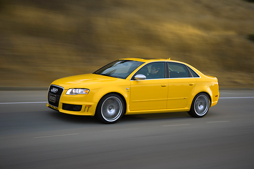 AUT 29 RK1200 01 © Kimball Stock 2007 Audi RS4 Yellow 3/4 Side View On Road In Motion