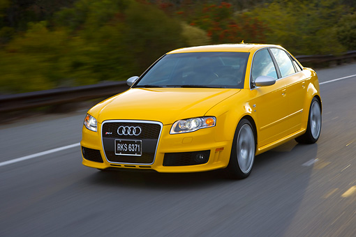 AUT 29 RK1202 01 © Kimball Stock 2007 Audi RS4 Yellow 3/4 Front View On Road In Motion